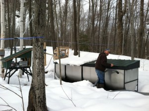 The old steel buckets with lids that had to be emptied by hand into wooden barrels on sleds drawn by horses are a thing of the past for modern-day maple syrup producers. Here John Keurulainen collects sap.