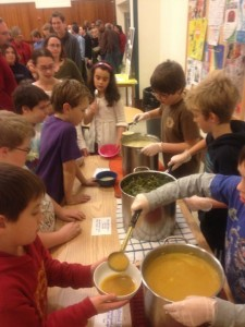 Fourth and fifth graders serving homemade soups and breads to Dubliners on Friday, November 30, at the Dublin Consolidated School. Just look at how long the line of people is!