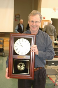 Chris Gallagher receives a wall clock for being selected as Citizen of the Year. Photo by Sally Shonk