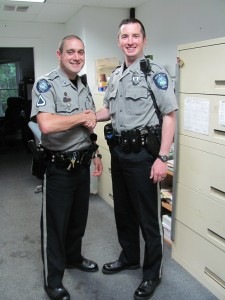 Officer Dan Cheshire (at right) welcomed by Master Patrolman Suokko.