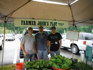 Farmer John's Plot is manned by Garret Sundstrom (center) and John Sandri (right). Jasen Woodworth (left) is their apprentice from last year and he is the farmer they are planning on hiring next year to expand the farm.