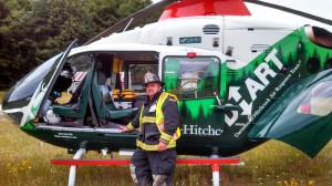 Justin Carpenter on duty by the medical helicopter at Weis Field after a recent accident.