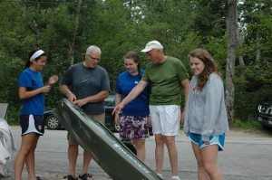 To prevent milfoil and other invasives from entering Dublin Lake from the public landing, Kenneth and Elizabeth DiCerare have their boat inspected by our Lake Hosts Olivia Thomas, Genna Weidner and Bill Goodwin. Photo by Sally Shonk