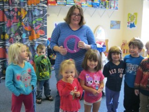 Jess Harrison at DCP, teaching music to the children. She is also the instrumental music teacher at DCS as well as a private instructor at Rousseau's Music in Jaffrey.