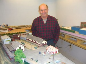 Larry Kemp shows his model railroad project based on earlier days of downtown Peterborough. Photo by Ramona Branch