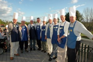 At the Monadnock Family Services benefit, Men Who Cook, a dozen Dublin cooks included Rusty Bastedo, Art Flick, Rob Seaver, Jeff Clough, Allen Davis, Bill Goodwin, Henry James, Jeff Oja, and Rick MacMillan (Perry Davis and Jim Bride not pictured). The event took place at the Shattuck Inn May 18 and the proceeds were for the benefit of the Adult Care Center in Jaffrey. Photo by Sally Shonk