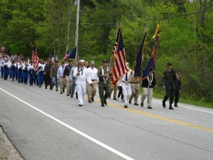 The Memorial Day Parade of 2014 progressed up Route 101 on May 26 with Band, Cadets, T-Ball troupe and townspeople following close behind en route to the cemetery to honor those who have made the greatest sacrifice of all to our country. Photo by Hal Close.