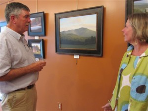 Dave Dodge, of Peterborough, discussing his Monadnock painting with Dublin resident, Mary Loftis. Photo by Sally Shonk