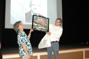 At the Dublin Historical Society's Annual Meeting last August 24, Henry James presented a painting by Daniel Thibeault to Sarah Bauhan, who retired from the board after five years of service. Photo by Sally Shonk