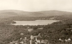 Aerial view of the lake and village before 1972. Antique postcard credit: Photo courtesy Dublin Historical Society