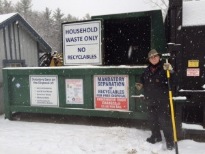Tom Kennedy stands at the ready outside the compactor at the Dublin Recycling Center. Photo by Margaret Gurney