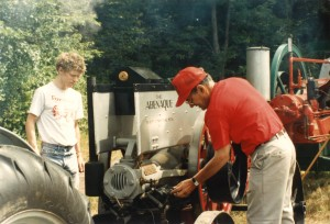 As his son Peter looks on, Bob is shown here fiddling with his Abenaque engine at a Dublin Engine Show. Taken in the early 1990s.