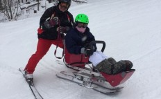 Mick assists a skier on a downhill run at Crotched Mountain.