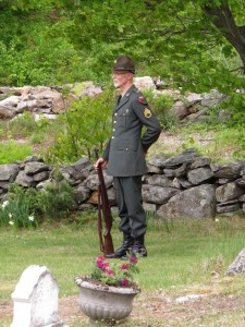 """Tim Murray at last year's Memorial Day as he stood ready to fire his rifle in a salute to those who have given their lives for our country. """"Taps"""" then followed. Photo by Hal Close."""