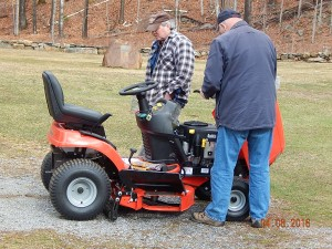 Cles Staples and Michael Edick inspecting the new cemetery tractor shortly after it arrived in Dublin April 7. Photo by Hank Campbell.