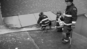 As a special part of their regular training exercises, the Dublin Volunteer Fire Department was able to practice roof ventilation techniques on a commercial building at the Dublin School in mid-June. A building was scheduled for demolition on the following day, allowing the firefighters to practice cutting holes through the roof. A new David E. Howe Administration Building will be completed by late fall. Firefighters: Andy Hungerford, Justin Carpenter and Andy Freeman is standing. Photo by Joe Sangermano